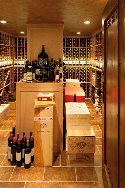 Traditional Wine Cellar with specialty door, can lights, travertine floors, Standard height, Crown molding