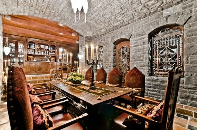 Rustic Dining Room with Built-in bookshelf, Chandelier, slate tile floors