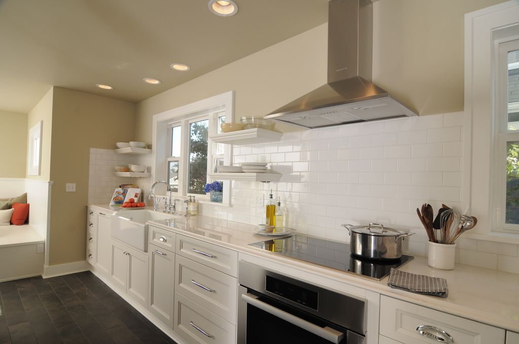 Contemporary Kitchen with slate tile floors, can lights, Farmhouse sink, Paint 1, Subway Tile, Corian counters, Window seat