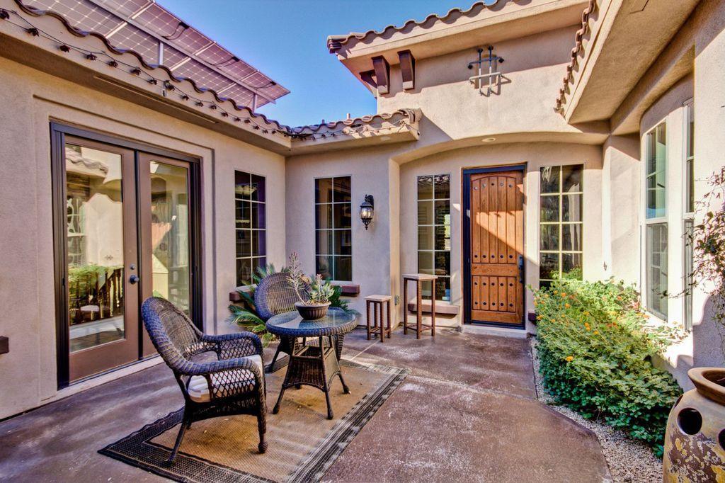 Mediterranean Front Door with French doors, exterior concrete tile floors, exterior tile floors