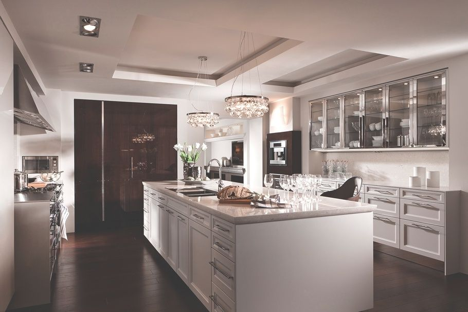Contemporary Kitchen with Undermount sink, U-shaped, Signature hardware deco glam chandelier, Stainless steel counters, Flush