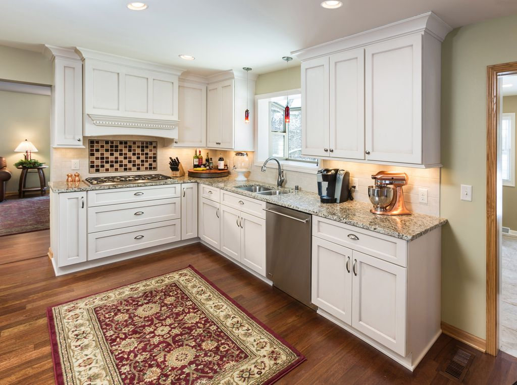 Traditional Kitchen with Custom hood, Pendant light, Multiple Sinks, Flat panel cabinets, full backsplash, Standard height