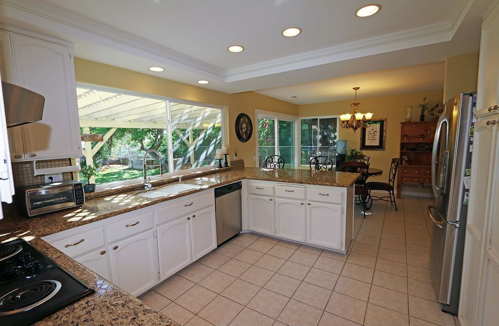 Traditional Kitchen with double-hung window, Multiple Sinks, Complex granite counters, Flat panel cabinets, Inset cabinets