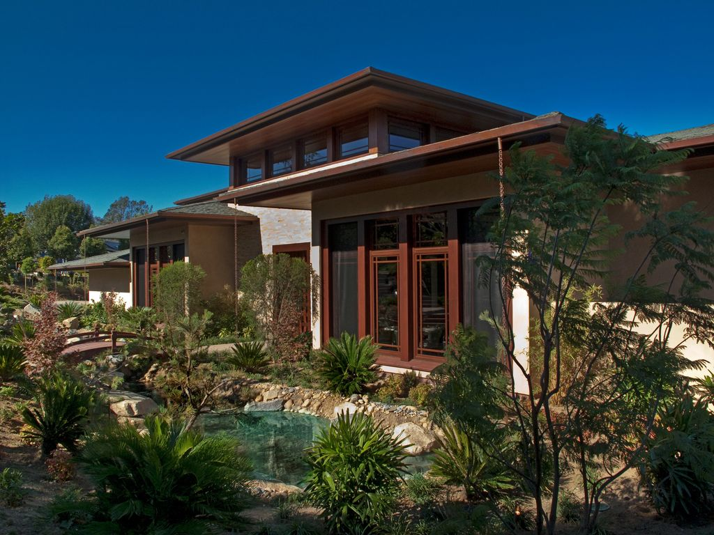 Asian Exterior of Home with Pond, Glass door, Paint