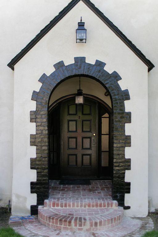 Traditional Front Door with six panel door, picture window, exterior brick floors, Pathway