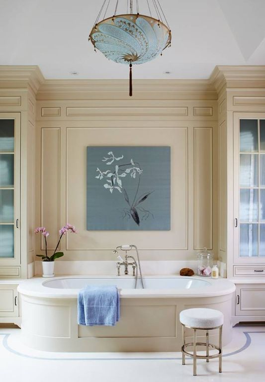 Traditional Master Bathroom with Chandelier, stone tile floors, can lights, Wainscotting, Glass panel, Inset cabinets, Paint