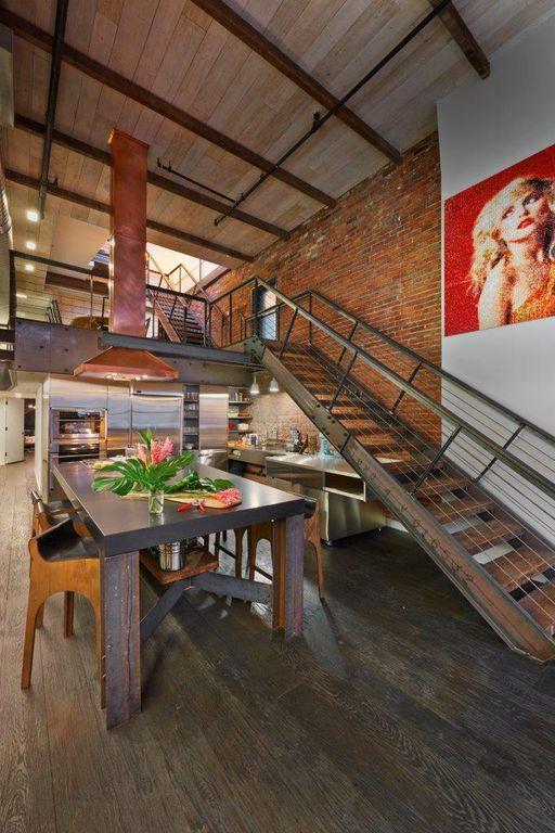 Modern Dining Room with Exposed beam, Hardwood floors, Loft, interior brick, High ceiling