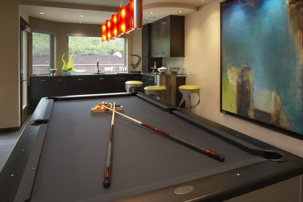 Contemporary Game Room with flush light, Built-in bookshelf, picture window, can lights, Standard height, Carpet