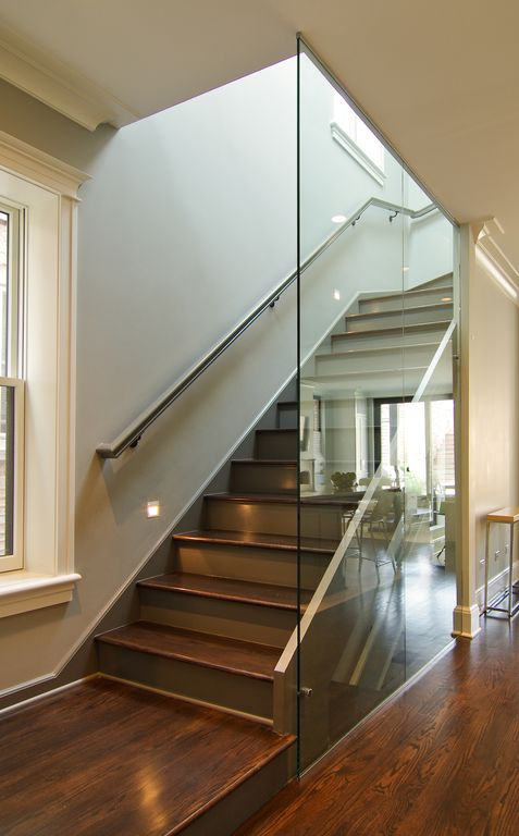 Contemporary Staircase with Hardwood floors, High ceiling, picture window, Crown molding, double-hung window