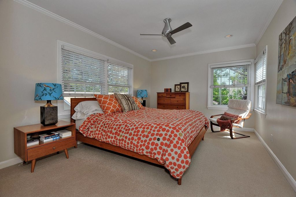 Contemporary Master Bedroom with Ceiling fan, can lights, double-hung window, Carpet, Crown molding, Standard height