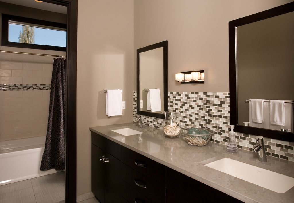 Modern Full Bathroom with shower bath combo, curtain showerdoor, picture window, stone tile floors, Corian counters, Paint
