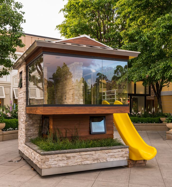 Contemporary Landscape/Yard with Built-in stone bench, Grass, exterior concrete tile floors, Raised beds, exterior awning