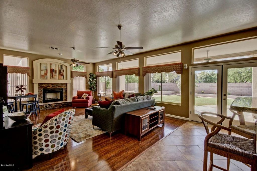 Mediterranean Living Room with Built-in bookshelf, French doors, Hardwood floors, Ceiling fan, Transom window