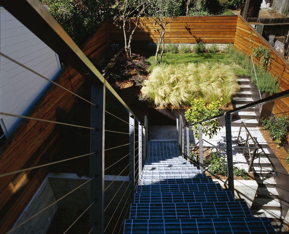 Contemporary Landscape/Yard with Fence, exterior concrete tile floors, Deck Railing, exterior tile floors