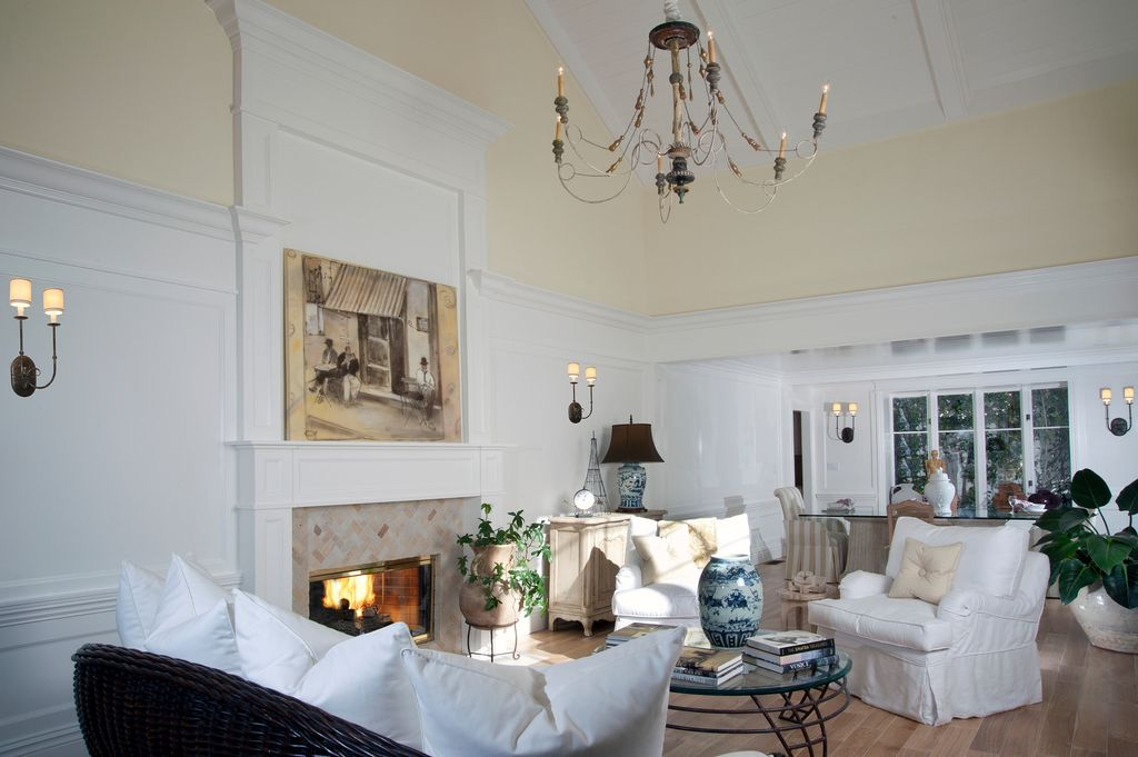 Traditional Living Room with Fireplace, Hardwood floors, Crown molding, Wall sconce, stone fireplace, High ceiling
