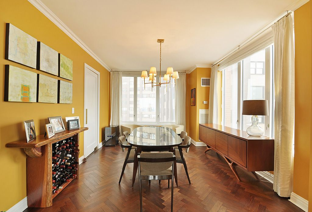 Contemporary Dining Room with Crown molding, Hardwood floors, Chandelier