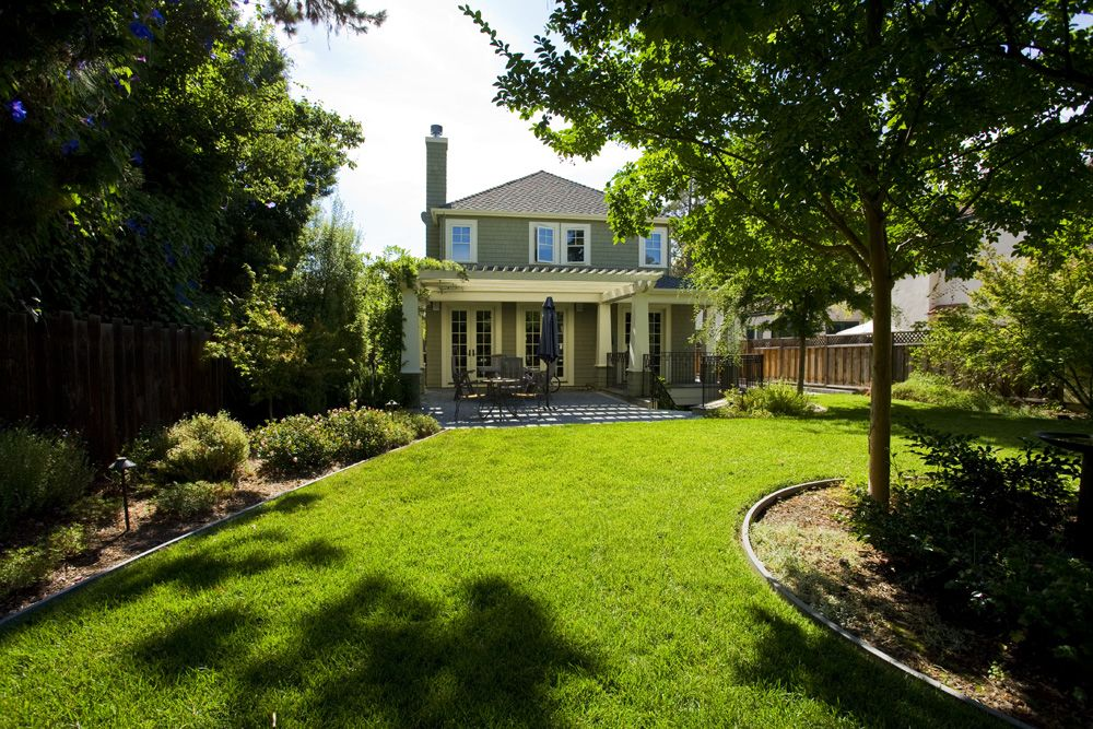 Craftsman Landscape/Yard with French doors, Pathway, exterior tile floors, Casement, Trellis, Deck Railing, Fence