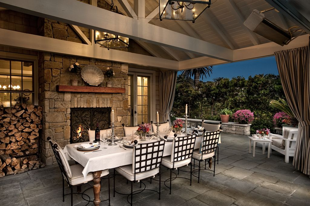 Traditional Porch with Exposed beam, exterior tile floors, Screened porch, French doors, Stacked stone fireplace