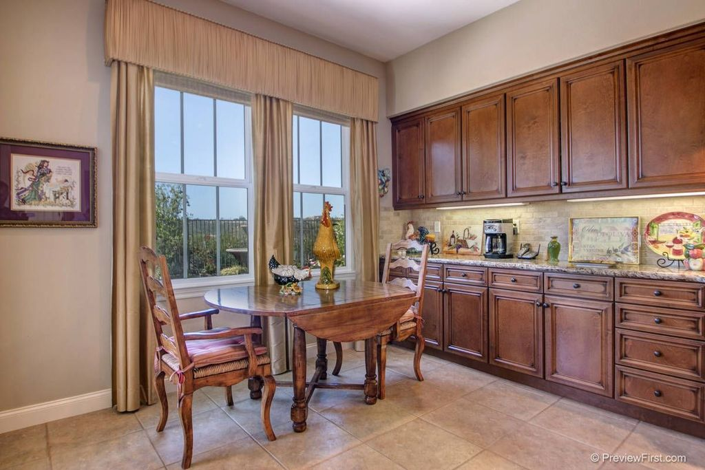 Traditional Dining Room with stone tile floors, limestone tile floors, double-hung window, Built-in bookshelf
