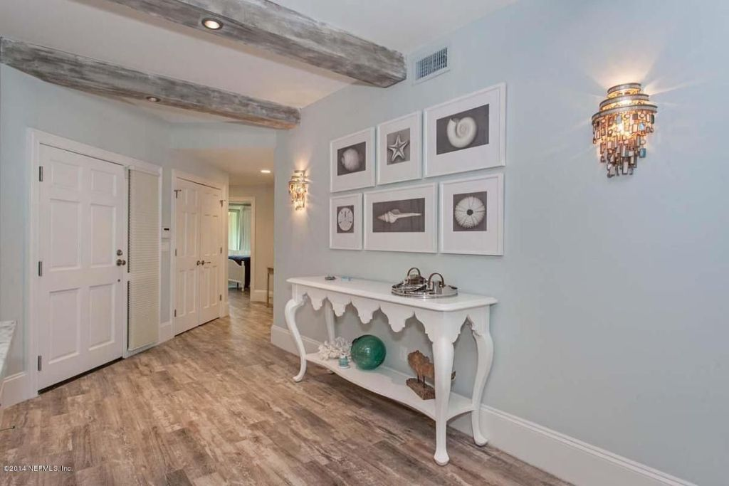Country Hallway with French doors, can lights, Standard height, Wall sconce, Exposed beam, Hardwood floors, six panel door