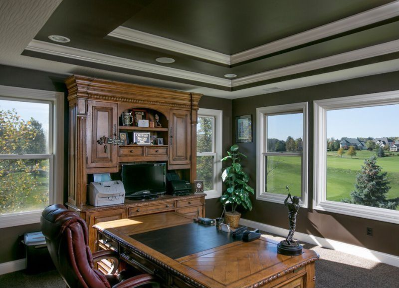 Traditional Home Office with Carpet, can lights, Built-in bookshelf, Crown molding, double-hung window, picture window