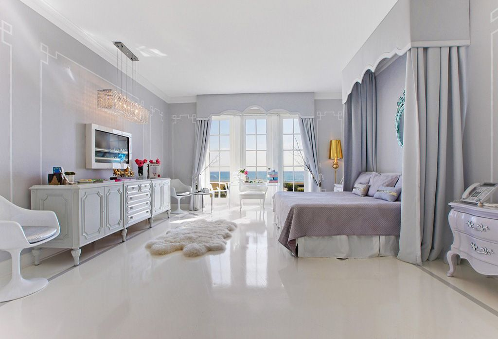 Contemporary Master Bedroom with interior wallpaper, Crown molding, Standard height, simple marble floors, Chandelier