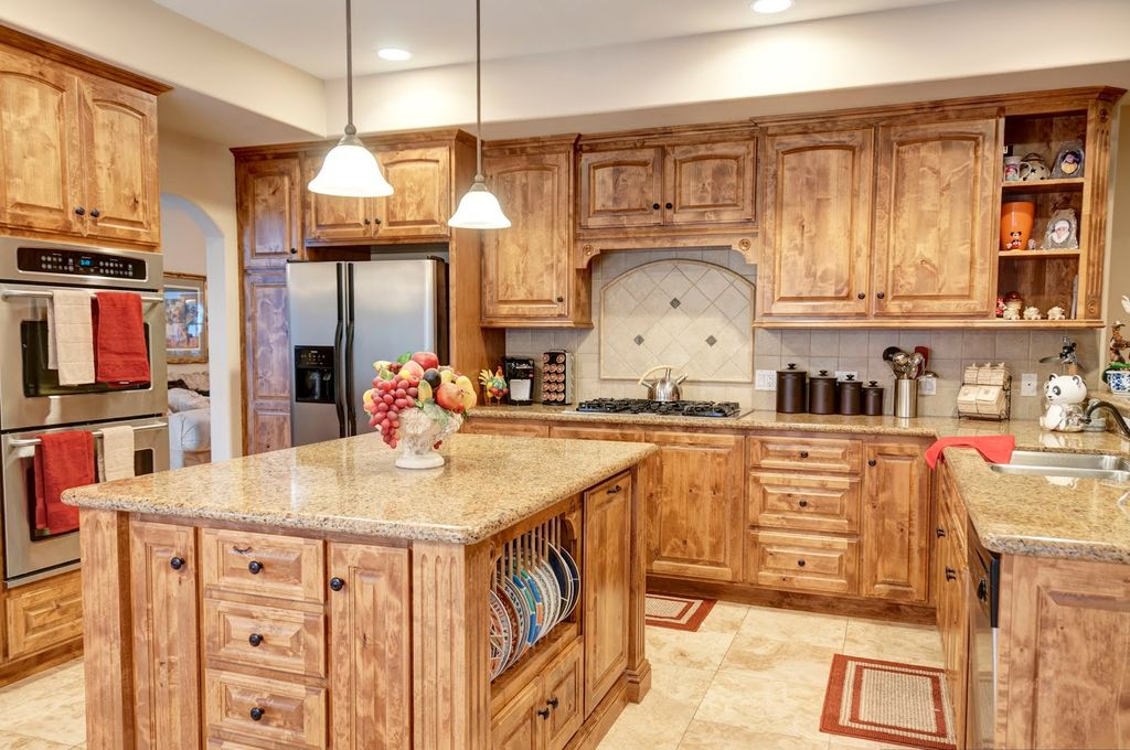 Country Kitchen with Raised panel, full backsplash, Multiple Sinks, U-shaped, Simple granite counters, Limestone Tile