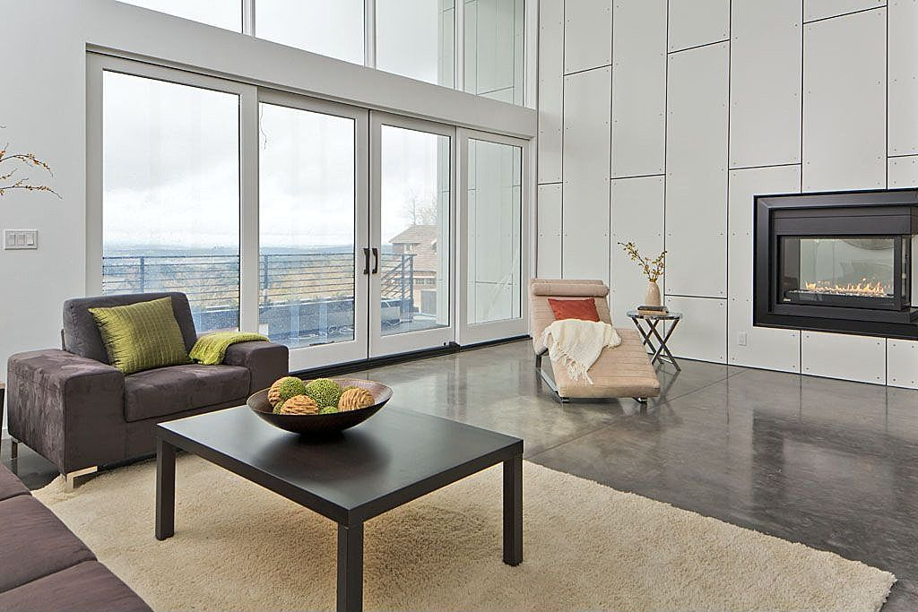 Modern Living Room with picture window, simple marble floors, insert fireplace, Standard height, French doors, Fireplace