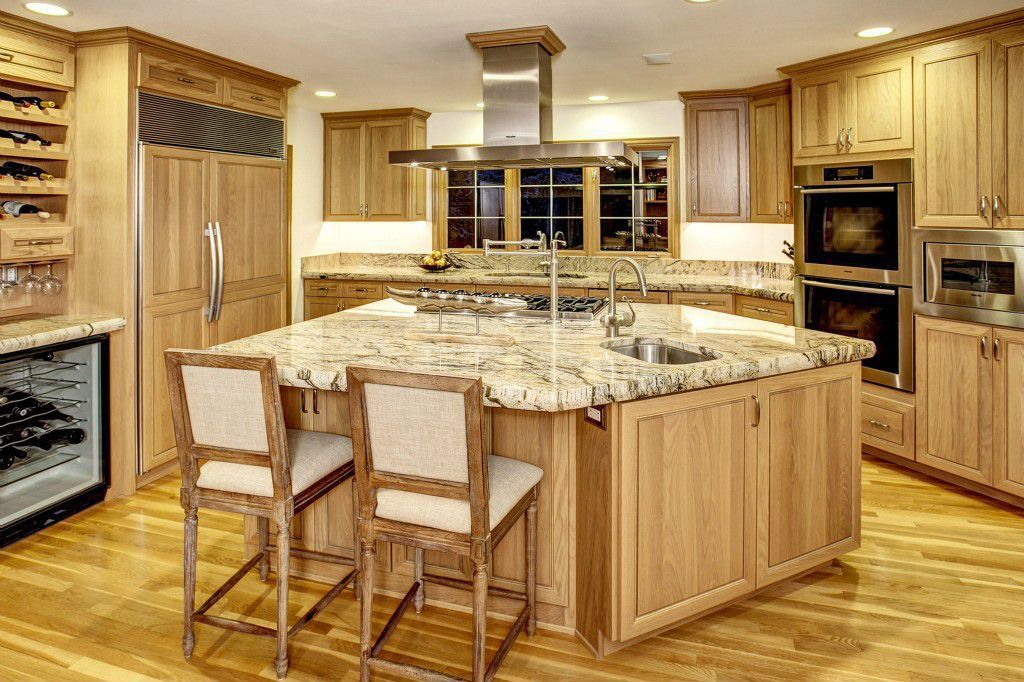 Traditional Kitchen with Raised panel, Kitchen island, Wine refrigerator, Undermount sink, Complex granite counters, Flush