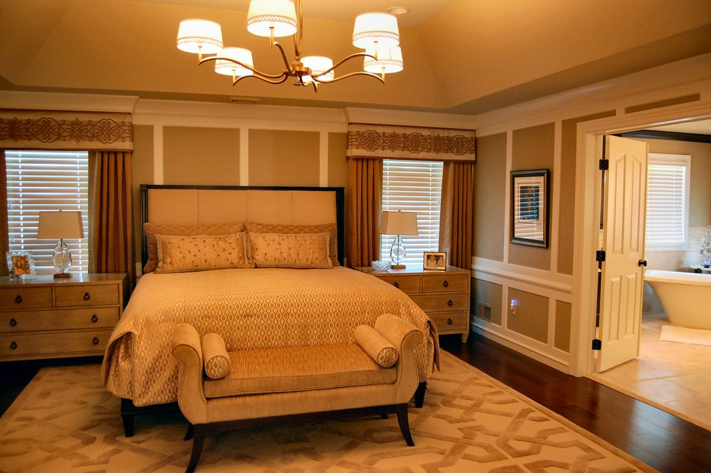Traditional Master Bedroom with specialty window, Crown molding, Standard height, Chandelier, Hardwood floors, Chair rail