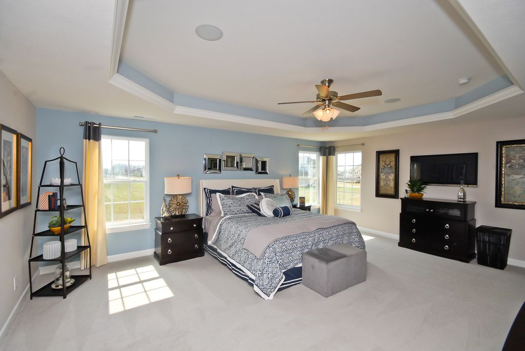 Master Bedroom with Ceiling fan, double-hung window, Carpet, Standard height, can lights, Chandelier