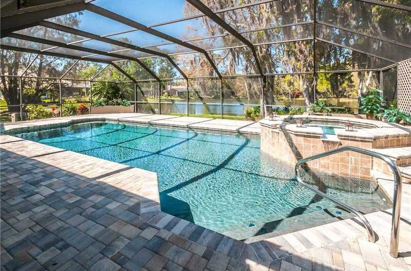 Contemporary Swimming Pool with Skylight, exterior stone floors, picture window, Pool with hot tub, Indoor pool