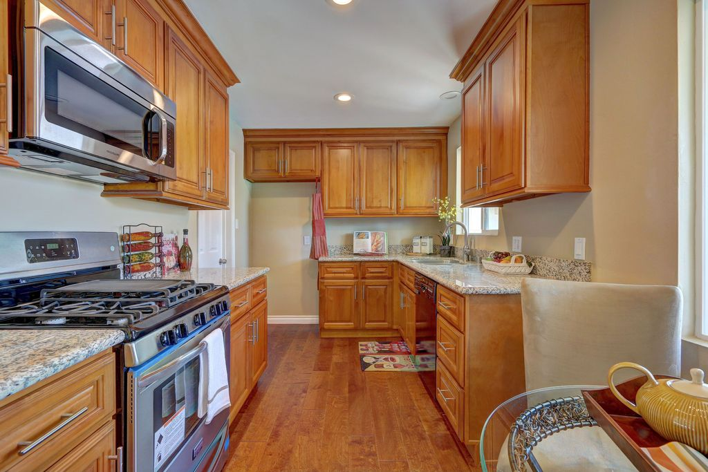 Traditional Kitchen with U-shaped, Inset cabinets, Raised panel, Standard height, Hardwood floors, specialty door, dishwasher
