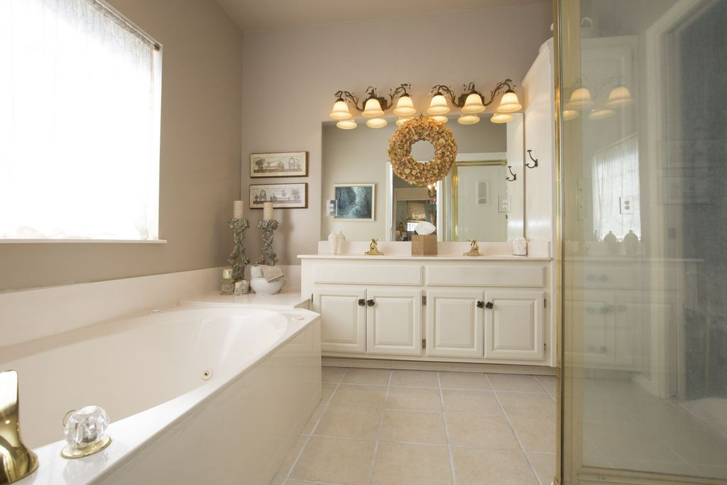 Traditional Master Bathroom with Paint, framed showerdoor, Double sink, drop in bathtub, full backsplash, Standard height