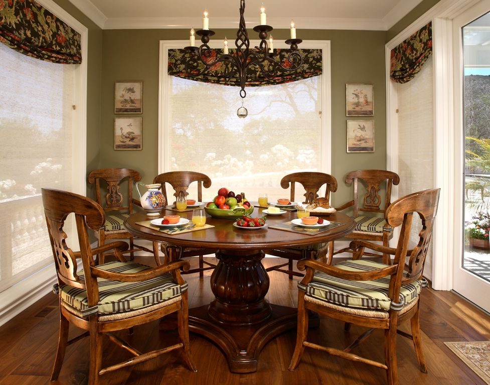Traditional Dining Room with Chandelier, Hardwood floors, Standard height, Crown molding, picture window