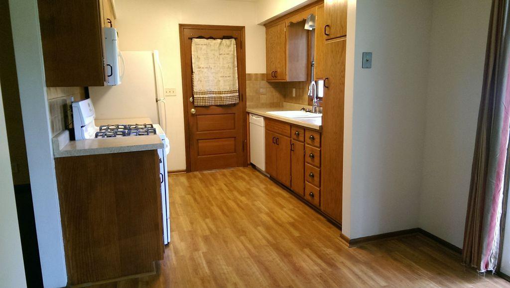 Craftsman Kitchen with Inset cabinets, Casement, full backsplash, Glass panel door, U-shaped, Stone Tile, dishwasher