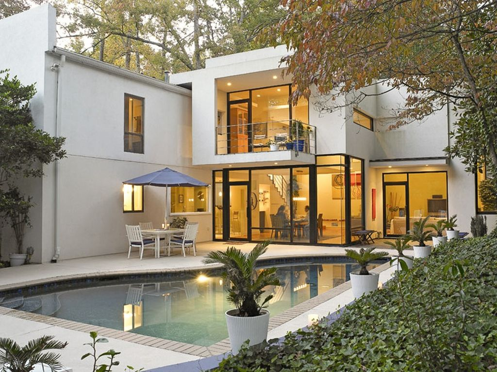 Contemporary Swimming Pool with French doors, specialty window, exterior tile floors, Deck Railing, Other Pool Type