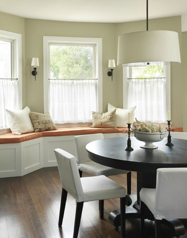 Traditional Dining Room with Wall sconce, Hardwood floors, Window seat, Pendant light