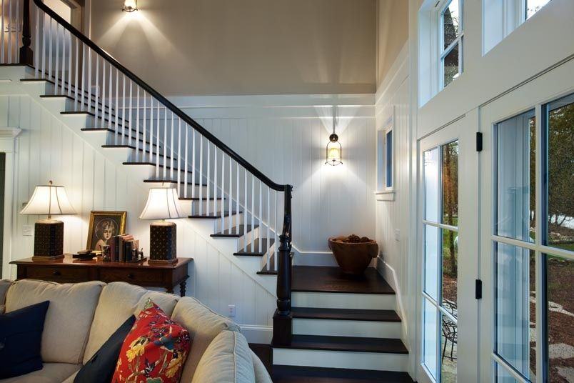Cottage Staircase with picture window, French doors, Wall sconce, Cathedral ceiling, Casement, Wainscotting, Hardwood floors