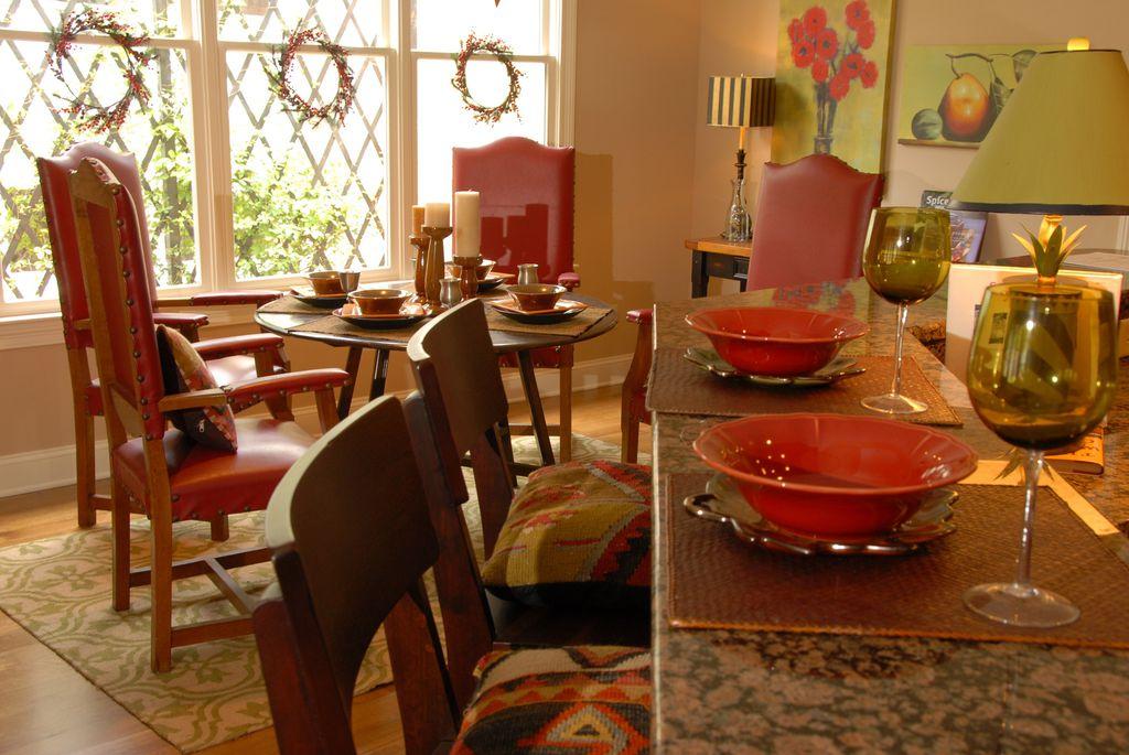 Eclectic Kitchen with Breakfast bar, Complex granite counters, double-hung window, Standard height, Breakfast nook