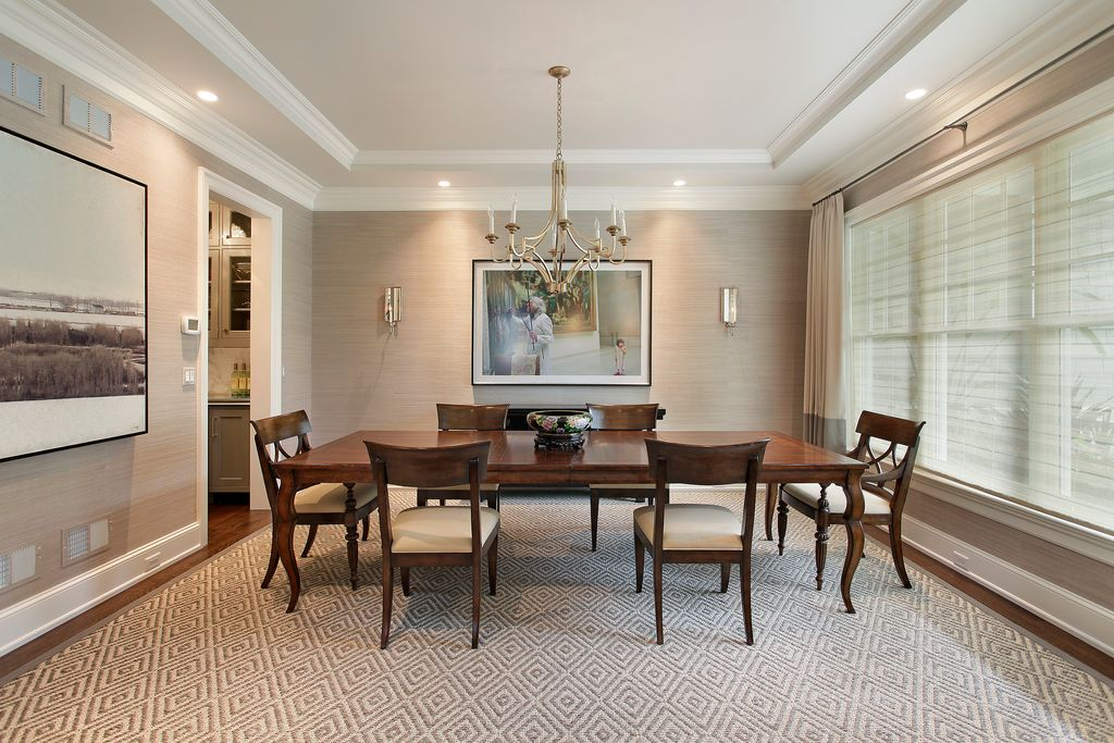 Traditional Dining Room with Standard height, Hardwood floors, Chandelier, Crown molding, can lights, Wall sconce