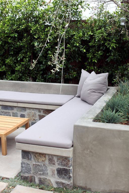 Contemporary Patio with Fence, exterior stone floors, Built-in bench seating, Outdoor cushion, Private patio, Raised beds