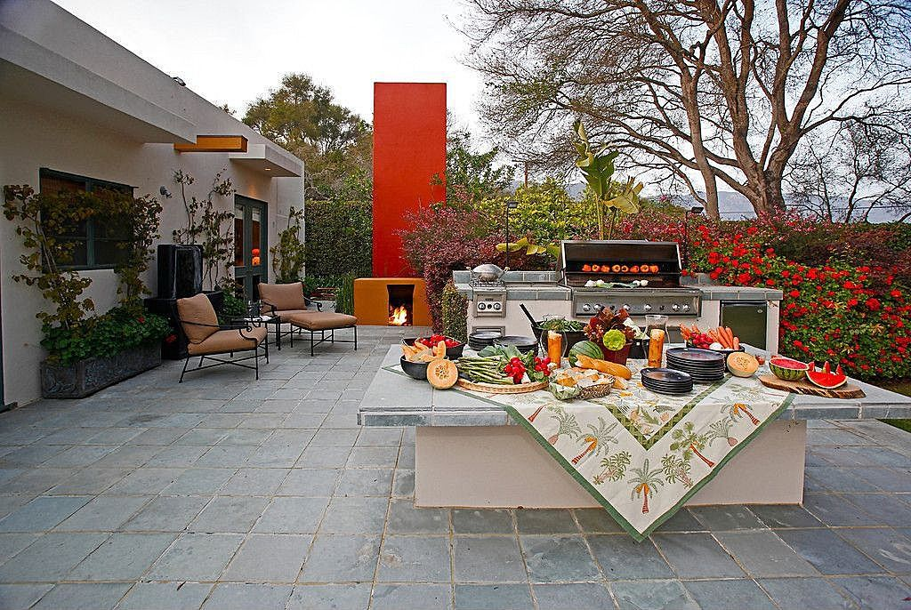 Eclectic Patio with picture window, French doors, Outdoor kitchen, Raised beds, outdoor pizza oven, exterior stone floors