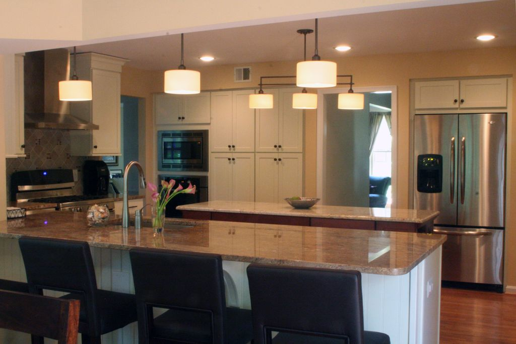 Contemporary Kitchen with Simple granite counters, U-shaped, Breakfast bar, Flush, Undermount sink, Flat panel cabinets