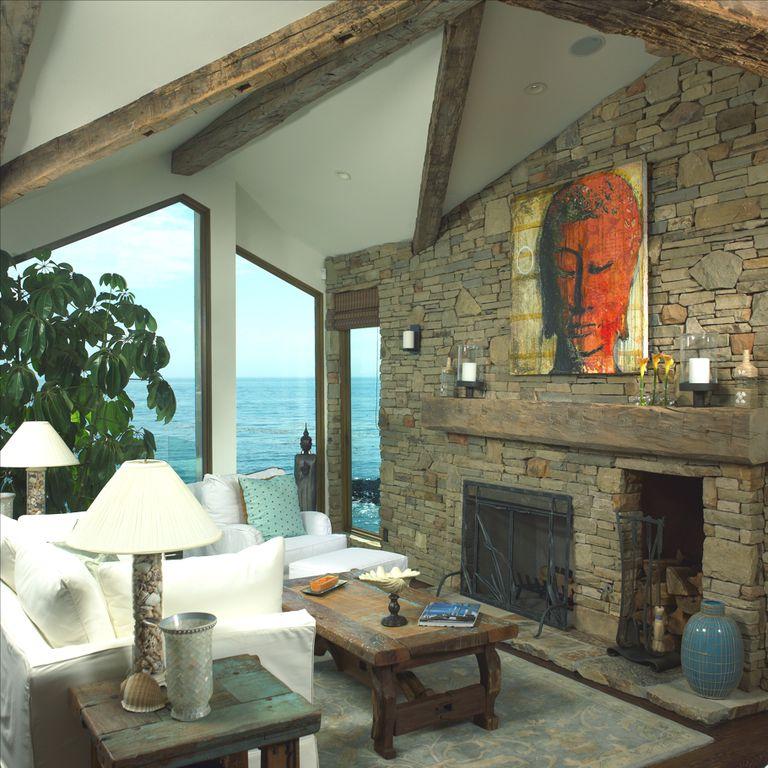 Rustic Living Room with RWA Rustic Kona Mantel, Eldorado Stone Mountain Ledge - Sierra, Hardwood floors, Built-in bookshelf