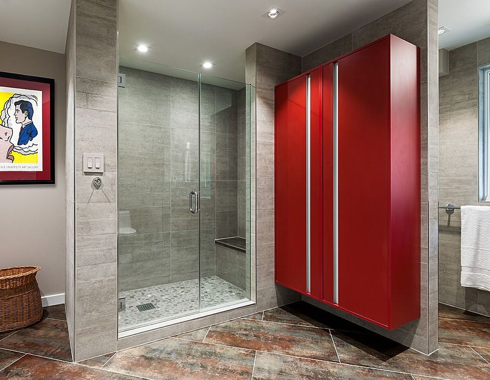 Contemporary Master Bathroom with Casement, Wall Tiles, frameless showerdoor, Shower, Wall sconce, stone tile floors