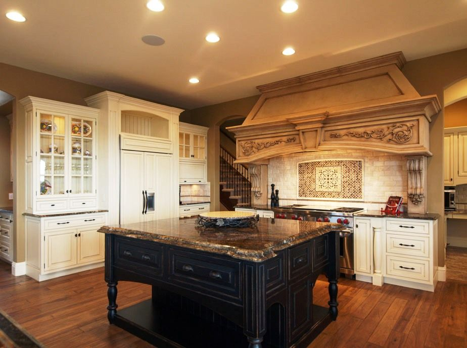 Traditional Kitchen with Glass panel, L-shaped, can lights, Raised panel, Standard height, Kitchen island, full backsplash