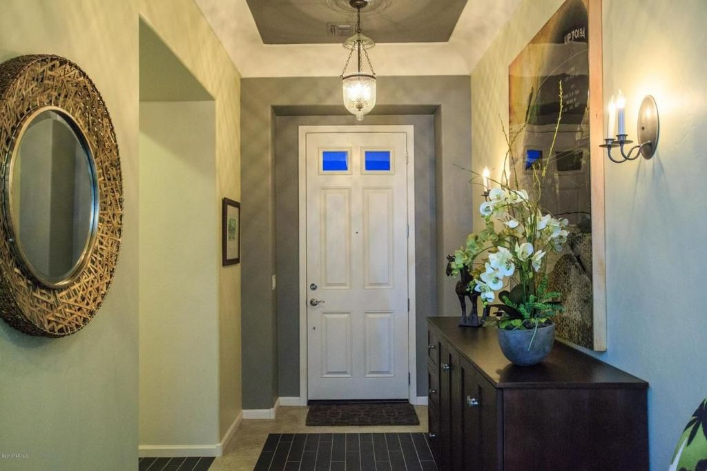 Eclectic Entryway with sandstone floors, Wall sconce, Pendant light, Standard height, Glass panel door, Crown molding