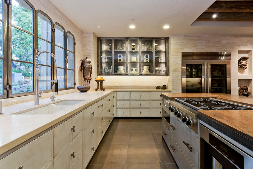 Contemporary Kitchen with Travertine counters, Wood counters, Glass panel, Ms International Juparana Arandis Granite