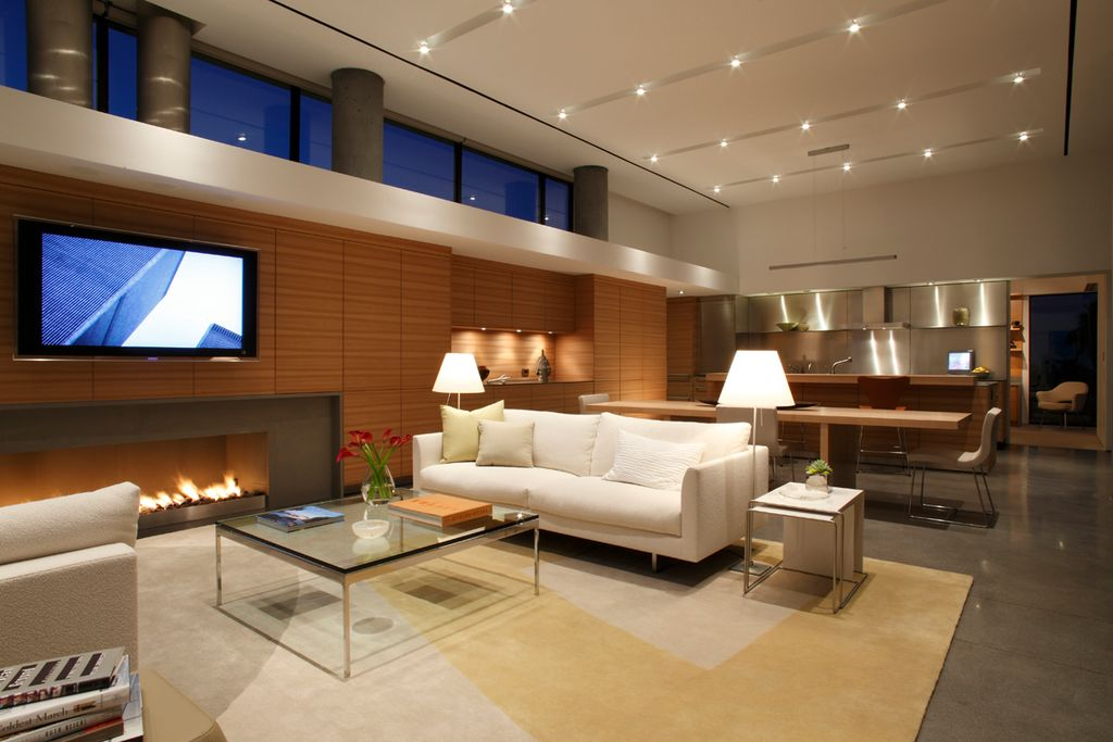 Contemporary Great Room with can lights, High ceiling, interior wallpaper, Fireplace, flush light, Concrete floors, Columns